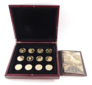 A Royal Mint gold plated set of Commemorative Coins, The Golden History of Powered Flight, cased