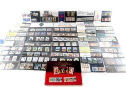 Philately. GB EII commemorative mint packs, pre and post decimalisation. (a quantity)