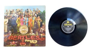 A Beatles Sgt Pepper's Lonely Hearts Club Band vinyl LP album, PMC7027, with card insert, 1967.