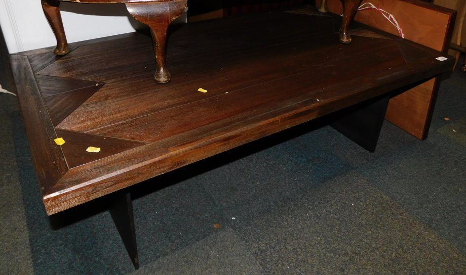 A dark wood coffee table with a steel twin pedestal base, 40cm high, 120cm wide, 70cm deep.