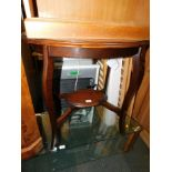 An Edwardian mahogany occasional table, with lower tier, 74cm high, 68cm wide, 45cm deep.