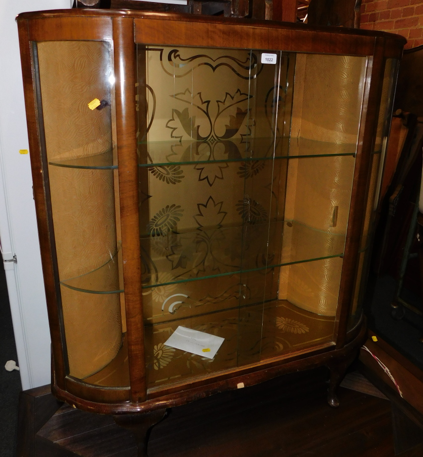 A mid 20thC walnut china cabinet, enclosing two glass shelves, with sliding doors, 117cm high, 105cm