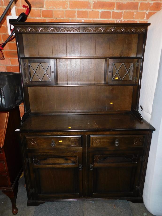 A dark oak veneered kitchen dresser, with open delft rack, above sideboard base, 180cm high, 125cm