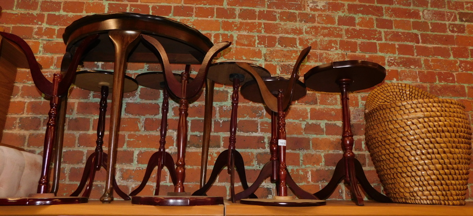 Eight reproduction wine tables, a walnut demi lune table, and a wicker linen box chair. (10)