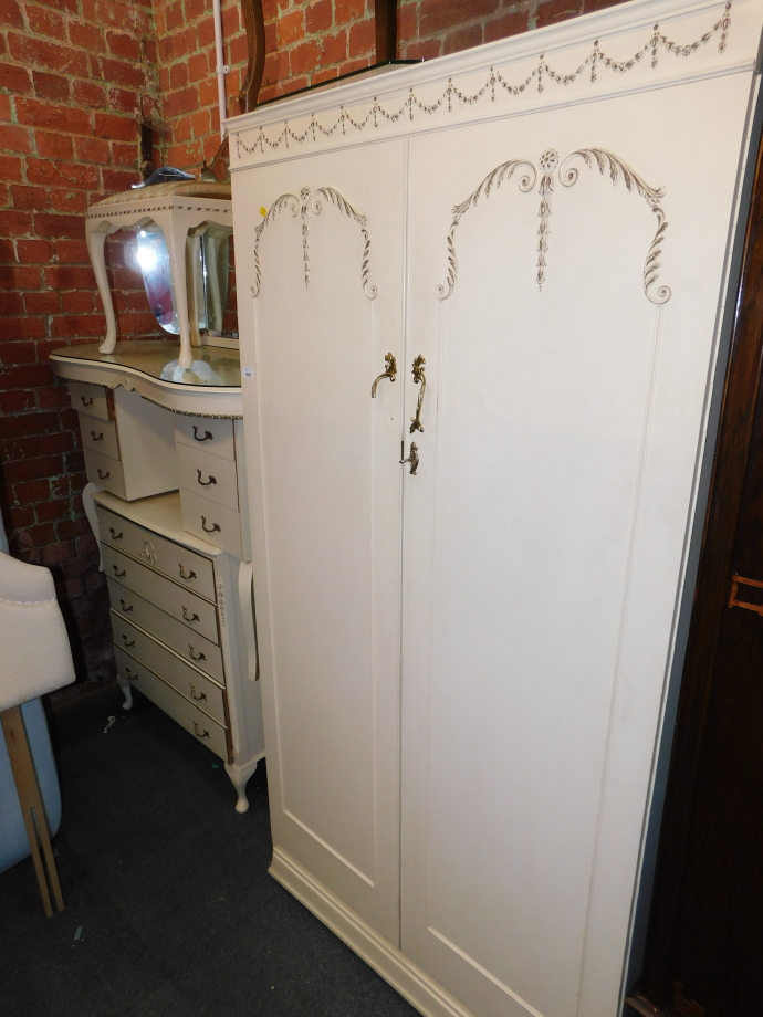 A cream painted French style bedroom suite, comprising wardrobe, 178cm high, 92cm wide, 54cm