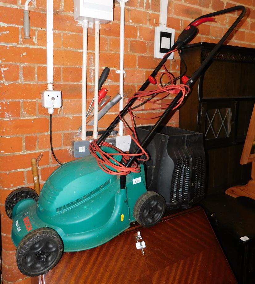 A Bosch Rotak 320 electric lawn mower.
