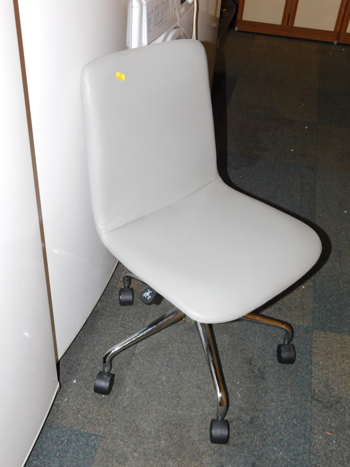 An office swivel chair, with grey leatherette upholstery. (AF)