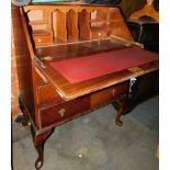 A 20thC mahogany bureau, with fitted interior above three drawers, 102cm high, 79cm wide, 45cm