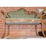 A reproduction two seater salon sofa, with carved show frame, upholstered in buttoned back green