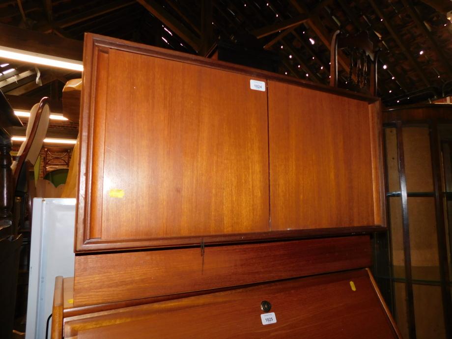 A vintage teak G-Plan record cabinet, with two sliding doors, 49cm high, 76cm wide, 46cm deep.