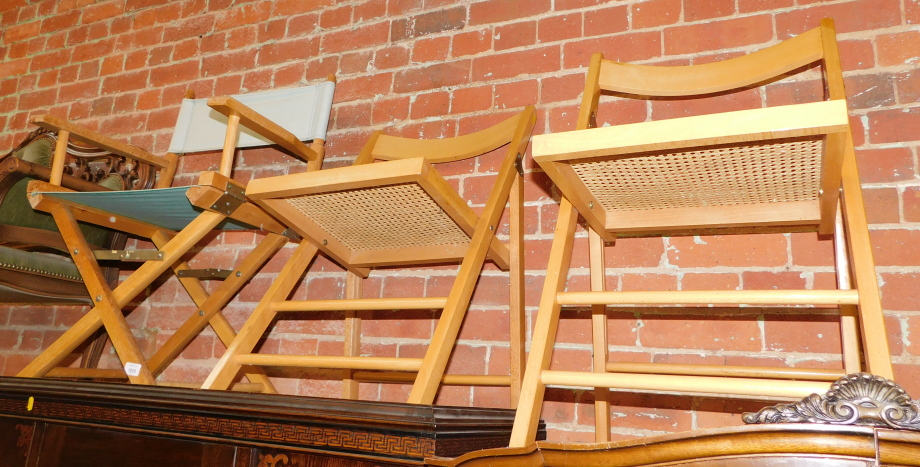 A folding director's chair, together with two folding cane seated chairs. (3)