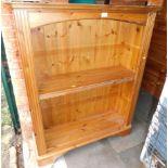 A pine bookcase, enclosing three adjustable shelves, 121cm high, 96cm wide, 31cm deep.