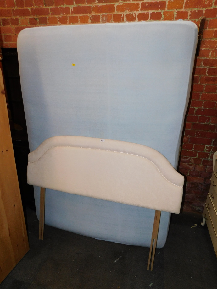 A double divan bed and mattress, together with a cream headboard. (3)
