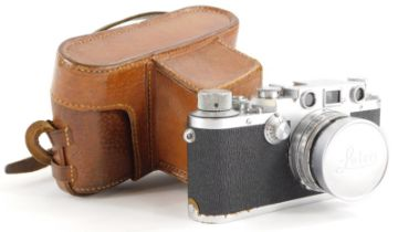 A Leica IIIc camera, serial number 500249, with a Leitz 5cm f2 Summitar lens, number 661835, in a le