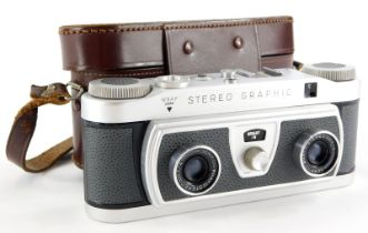 A Wray stereo graphic twin lens camera, in a leather case.