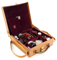A tan bespoke pigskin suitcase, containing mixed Leica accessories.