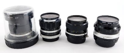 Four camera lenses to fit Nikon cameras, to include a Nikkor 18mm f3.5 super wide angle lens, a Nikk