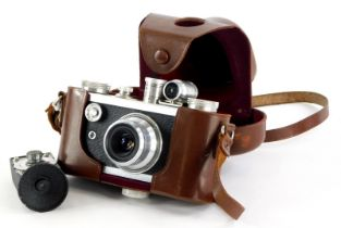 A Corfield Peroflex 1 camera, with a f3.5 Resolux lens, in a leather case, and a vintage Corfield Ex