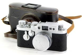 A Leica IIIG camera, serial number 981064, with a Leitz 5cm f2.8 Elmar lens, number 1619673, in a le
