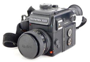 A Rolleiflex 3003 SLR camera, with Zeiss Planar f1.8 50mm lens.