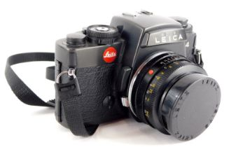 A black Leica R4 single lens reflex camera, with a Leitz Summicron 50mm f2 lens, number 2666242.
