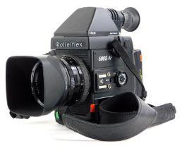 A Rolleiflex 6008AF camera, with Zeiss Planar f2.8 50mm lens, Pentaprism and handgrip.