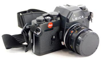 A black Leica R3 single lens reflex camera, with a Leitz 28mm f2.8 Elmarit R wide angle lens, number