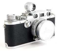 A Leica IIIf camera, serial number 608750, bearing engraved name Tahir to back, with a Leitz 5cm f2