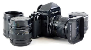 A Pentax 67 camera, with 55mm f4 SMC lens and hood, and a 165mm f4 SMC lens, with a set of auto exte