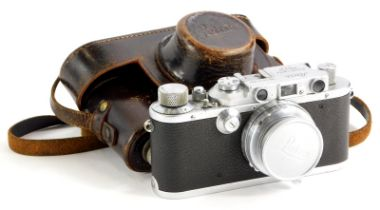 A Leica III camera, serial number 163566, with a Leitz 5cm f2 Summar lens, number 403494, in a leath