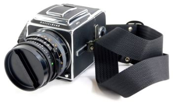 A Hasselblad 501cm camera, with Zeiss Planar F3.5 100mm lens, WLF and A12 film back.