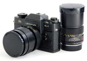 A black Leicaflex SL2 SLR camera, with a Leitz 35-70mm Vario-Elmar zoom lens, and a Leitz Elmarit R