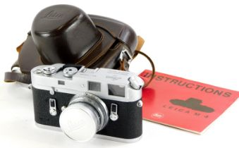 A Leica M4 camera, serial number 1270524, with a Leitz 5cm f2 Summicron lens, number 1156983, in a l