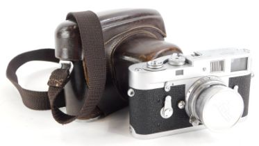 A Leica M2 camera, serial number 1069861, with a Leitz 5cm f2 Summicron lens, number 1326017.