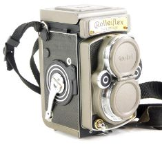 """A rare Rolleiflex 2.8GX edition """"60 Years of Rolleiflex 1929-1989"""" camera, the camera with a gold pl"""
