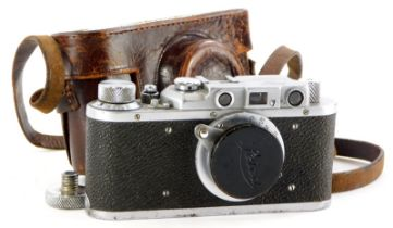 A Leica IIIa camera, serial number 357642, with a Leitz 5cm f3.5 Elmar lens, in a leather case.
