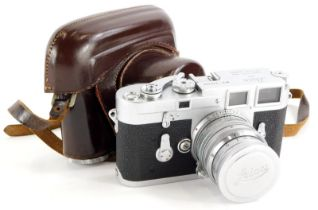 A Leica M3 double wind camera, serial number 776666, with a Leitz 5cm f1.5 Summarit lens, number 138