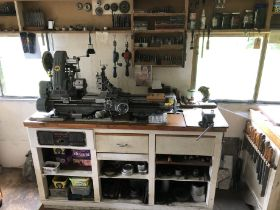 A Myford lathe workstation, comprising single phase bench top lathe, and the illustrated tooling, in