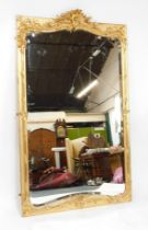 A George III style gilt wood and gesso ballroom mirror, with rococo C scroll frame enclosing a shape