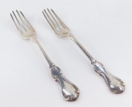 A pair of Victorian entree forks, decorated in the hourglass pattern, crest engraved, John James Wh