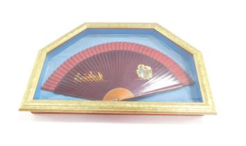 An early 20thC Chinese presentation fan, with various signatures, the centre set with various figure