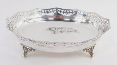 A George V silver dish, the dodecahedral body with a pierced rim on quadruple scroll feet, Birmingha