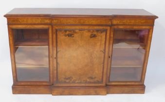 A Victorian figured and burr walnut veneered breakfront credenza, with mahogany cross banded and str
