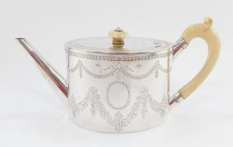 A Victorian silver teapot, the oval body with ivory handle and knop, plain spout, chased with garlan