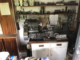 A Denham lathe workstation, comprising single phase bench top lathe, upper shelves with colletts, dr