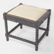 A 19thC Dutch ebony stool, with Arabesque channeled carved top, with scroll and griffin frieze suppo