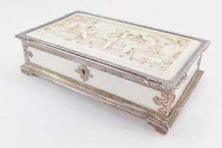 A Victorian silver and ivory box, of rectangular form, the lid heavily carved with three cherubs pla