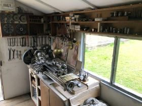 A Myford lathe workstation and accessories, comprising single phase bench top lathe, and tooling as