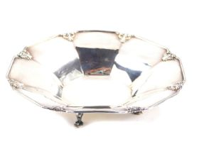 A George V silver octagonal dish, with stylised gadrooned shell decoration, raised on four hoof feet