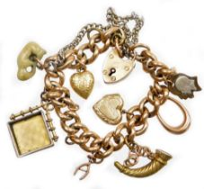 A 9ct gold charm bracelet, with various charms, on curb link bracelet, marked 9c to links, with a 9c